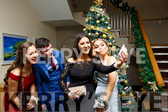 Eimear Brosnan, Ronan Dalton, Nela Vugayova and Muireann Ni Mhuircheartaigh (All Tralee) attending the Gaelcholáiste Chiarrai Debs in the Ballyroe Heights Hotel on Tuesday night last.