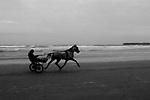 Jaunting car on Lahinch beach at dusk, Co. Clare, Ireland