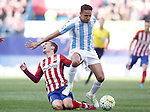 Atletico de Madrid's Antoine Griezmann (l) and Malaga CF's Weligton Robson during La Liga match. April 23,2016. (ALTERPHOTOS/Acero)
