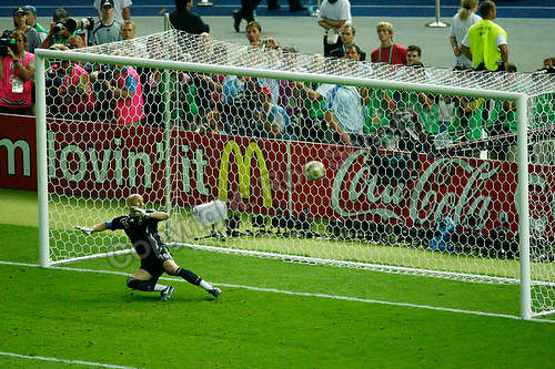 Jul 9, 2006; Berlin, GERMANY; France goalkeeper (16) Fabien Barthez watches as the game ending penalty kick by Italy defender (3) Fabio Grosso goes into the goal in the final of the 2006 FIFA World Cup at the Olympiastadion, Berlin. Italy defeated France 5-3 on penalty kicks following a 1-1 draw after extra time. Mandatory Credit: Ron Scheffler-US PRESSWIRE Copyright © Ron Scheffler
