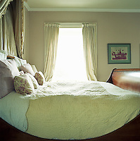 Light from the sash window floods into the master bedroom and over the sleigh bed that dominates the room