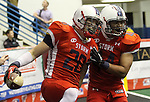 SIOUX FALLS, SD - JUNE 23:  Dan O'Keefe #20 from the Sioux Falls Storm celebrates an interception with teammate Dejuan Fulghum #44 in the first quarter of their first round playoff game against the Lee Valley Steelhawks Saturday night at the Sioux Falls Arena. (Photo by Dave Eggen/Inertia)