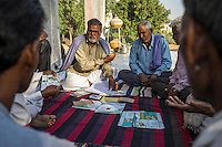 A group of guar farmers hold a committee meeting in Bamanwali village, Bikaner, Rajasthan, India on October 24th, 2016. Non-profit organisation Technoserve works with farmers in Bikaner, providing technical support and training, causing increased yield from implementation of good agricultural practices as well as a switch to using better grains better suited to the given climate. Photograph by Suzanne Lee for Technoserve