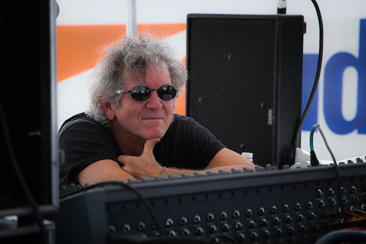 Rodney Crowell watches Ben Bullington's set from the sound board