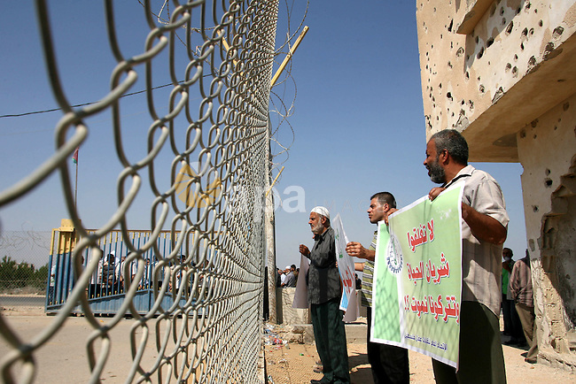 Palestinians participate a protest against Israeli siege imposed on Gaza strip during a rally in Rafah in the southern Gaza Strip, on Oct. 10, 2012. Photo by Eyad Al Baba