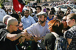 Neo-Nazis at left, try to retreive their flag from counter-protesters during a Neo-Nazi protest in front of fast food restaurant on Madison Street in Riverside, Ca, on Saturday, Sept. 26, 2009. The Neo-Nazis are calling for a mass deportation of illegal immigrants.