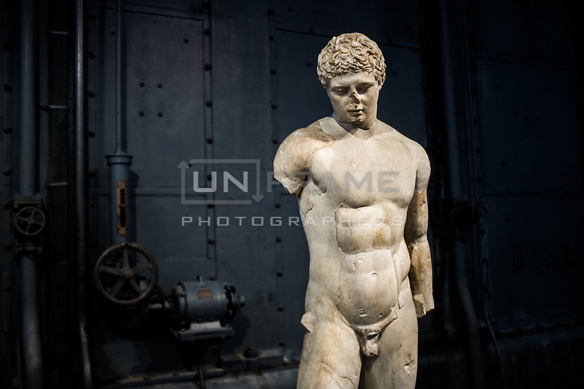 A series of sculptures with various provenances bears witness to two phenomena very wide-spread in Ancient Rome: the habit of collecting antiques and the diffusion of Greek models through copies of the original sculpture. Sculpture copy after Greek model. Hall of the Machines. Centrale Montemartini. Rome, Italy. Mar. 07, 2015