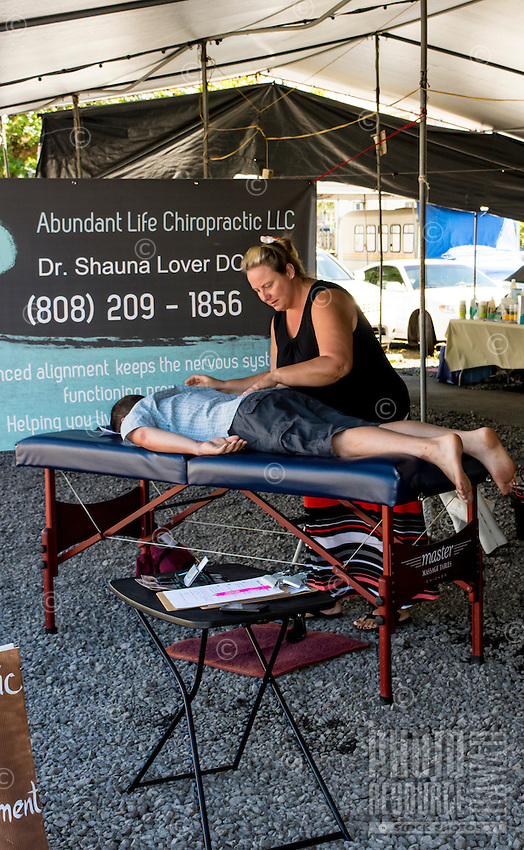 Chiropractic care by Dr. Shauna Lover at the Hilo Farmers Market, Big Island of Hawai'i.