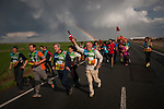 "People run on the 20th Korrika. Lodosa. (Basque Country). March 31, 2017. The ""Korrika"" is a relay course, with a wooden baton that passes from hand to hand without interruption, organised every two years in a bid to promote the basque language. The Korrika runs over 11 days and 10 nights, crossing many Basque villages and cities. This year was the 20th edition and run more than 2500 Kilometres. Some people consider it an honour to carry the baton with the symbol of the Basques, ""buying"" kilometres to support Basque language teaching. (Gari Garaialde / Bostok Photo)"