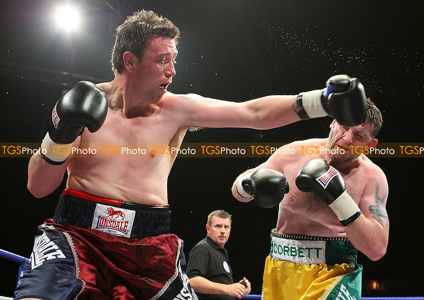 Darren Corbett (Belfast, green/yellow shorts) defeats Micky Steeds (Isle of Dogs, red/black shorts) - Round One of Prizefighter 'The Cruiserweights' Boxing contest at Earls Court, London - 19/05/09 - MANDATORY CREDIT: Gavin Ellis/TGSPHOTO - Self billing applies where appropriate - 0845 094 6026 - contact@tgsphoto.co.uk - NO UNPAID USE.