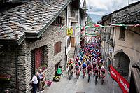peloton rolling through town<br /> <br /> Stage 14: Saint Vincent to Courmayeur/Skyway Monte Bianco (131km)<br /> 102nd Giro d'Italia 2019<br /> <br /> ©kramon
