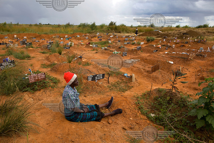 70 year old Sisilia visits the unmarked grave of her granddaughter Melody, who died from cholera aged 18. The number of deaths from cholera in Zimbabwe steadily increased towards the end of 2008.  ..