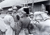 BNPS.co.uk (01202 558833)<br /> Pic: LashendenMuseumCollection/BNPS<br /> <br /> 1945 Dannenberg - Major Fritz Hahn the garrison commander at Dannenberg (center, with back to camera) is interrogated by American troops.<br /> <br /> An incredibly-rare Kamikaze-version of Adolf Hitler's deadly V1 terror weapon is about to go on display at a British museum 47 years after it was saved from destruction.<br /> <br /> The piloted 'Doodlebug' was effectively a one ton suicide bomb designed to strike at specific targets like Buckingham Palace and the Houses of Parliament.<br /> <br /> Unlike the extremely inaccurate unmanned version, these V1's were designed to be dropped from Heinkel bombers and then piloted directly onto their targets, but fortunately although 175 were made they were never put to use.<br /> <br /> One of the handfull that exist today belongs to the Lashenden Aviation Museum in Kent which have spent &pound;40,000 having it restored and are about to put it on display in a new purpose built hangar.