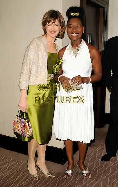 KATIE DERHAM & FLOELLA BENJAMIN .2009 Costa Book Awards, Intercontinental Hotel, London, .England, January 27th 2009..full length green silk satin dress gold beaded jacket bag waistband shoes white halterneck gold bow in hair clip silver shoes sandals .CAP/CAN.©Can Nguyen/Capital Pictures