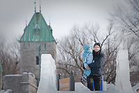 Dominick Miserandino and his daughter Caterina prepare to ride an ice slide at the Quebec Winter Carnival (Carnaval de Quebec) in Quebec city, February 3, 2010. With close to one million participants, it has grown to become the third largest winter celebration in the world.