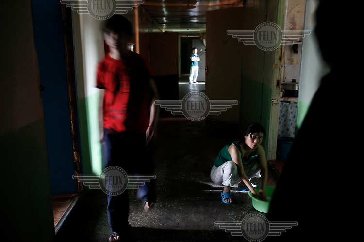 Chinese migrants cook in their dormitory after working in a market in Khabarovsk city on the bank of the Amur River. The Amur runs along the border separating Russia and China.