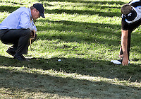03 AUG 13 PGA Rules Official Steve Rintoul assists Stuart Appleby with a complicated drop on18 during Saturdays Third Round at The Reno Tahoe Open at The Montreux Country Club in Reno, Nevada.  (photo:  kenneth e.dennis / kendennisphoto.com)