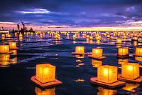 Spectators at Hawai'i's Annual Lantern Floating Ceremony mark the moment at sunset, Ala Moana Beach Park, O'ahu.