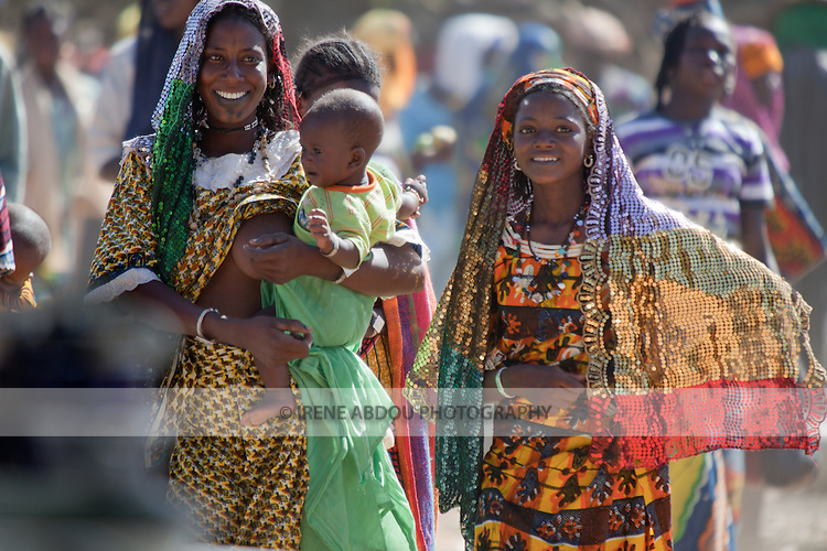 Fulani women at the village market of Bourro in northern Burkina Faso.  The Fulani are traditionally nomadic pastoralists, crisscrossing the Sahel season after season in search of fresh water and green pastures for their cattle and other livestock.