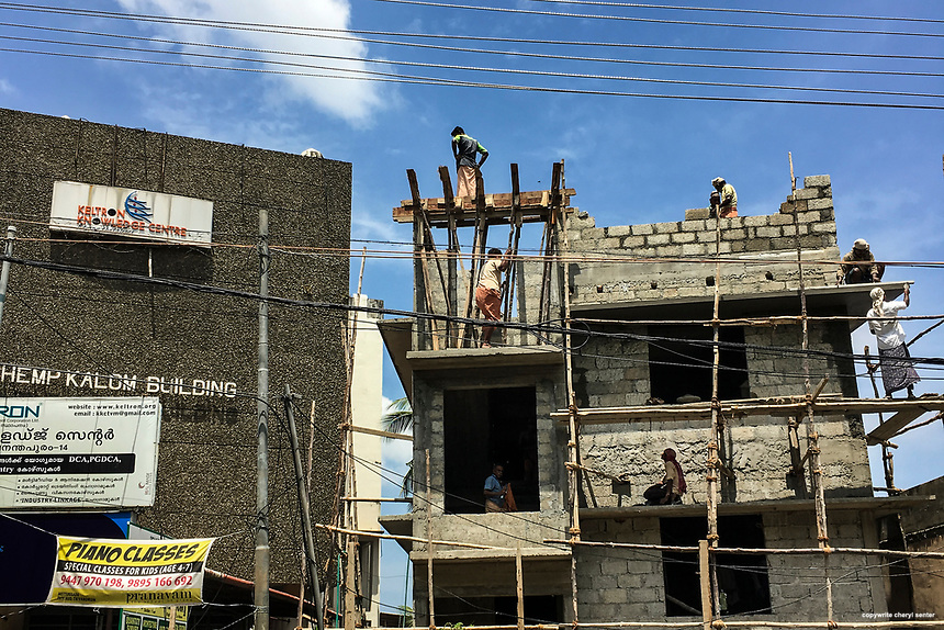 Construction workers use wooden scaffolding to build a structure in Thiruvananthapuram, India,  June 8, 2017 (Cellphone Photo by Cheryl Senter)