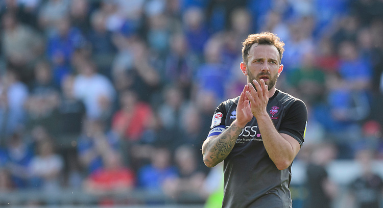 Lincoln City's Neal Eardley applauds the fans at the final whistle<br /> <br /> Photographer Chris Vaughan/CameraSport<br /> <br /> The EFL Sky Bet League Two - Carlisle United v Lincoln City - Friday 19th April 2019 - Brunton Park - Carlisle<br /> <br /> World Copyright © 2019 CameraSport. All rights reserved. 43 Linden Ave. Countesthorpe. Leicester. England. LE8 5PG - Tel: +44 (0) 116 277 4147 - admin@camerasport.com - www.camerasport.com