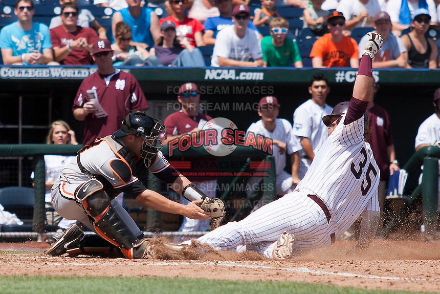 Mississippi State first baseman Wes Rea (35) slides home as Oregon State catcher Jake Rodriguez (13) tags him out during Game 11 of the 2013 Men's College World Series against the Oregon State Beavers on June 21, 2013 at TD Ameritrade Park in Omaha, Nebraska. The Bulldogs defeated the Beavers 4-1, to reach the CWS Final and eliminating Oregon State from the tournament. (Andrew Woolley/Four Seam Images)