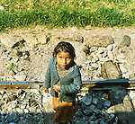 Peru Beggar Girl on Railroad tracks