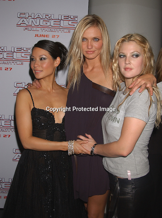 """..Lucy Liu and Cameron Diaz and Drew Barrymore..at  """"Charlie's Angels Full throttle"""" movie screening on ..June 25,2003 at the Loews Lincoln Center in New York ..City.  Photo by Robin Platzer, Twin Images"""