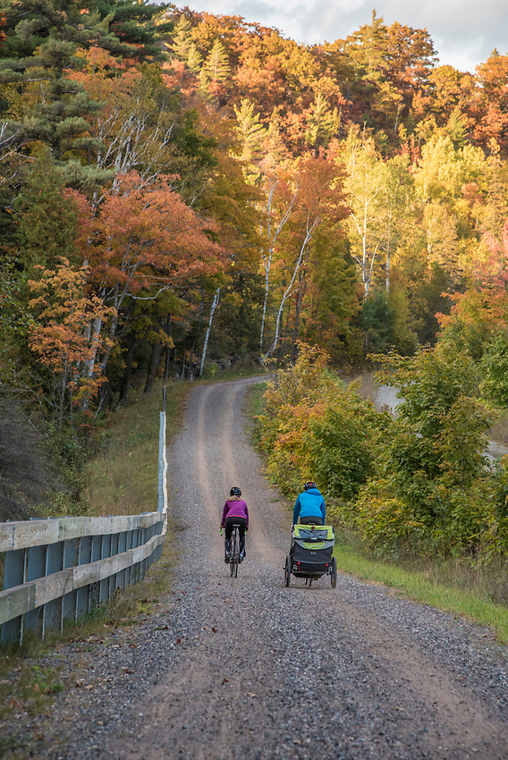 Family biking along the Iron Ore Heritage Trail, a multiuse recreation trail connecting communities in Marquette County on Michigan's Upper Peninsula.
