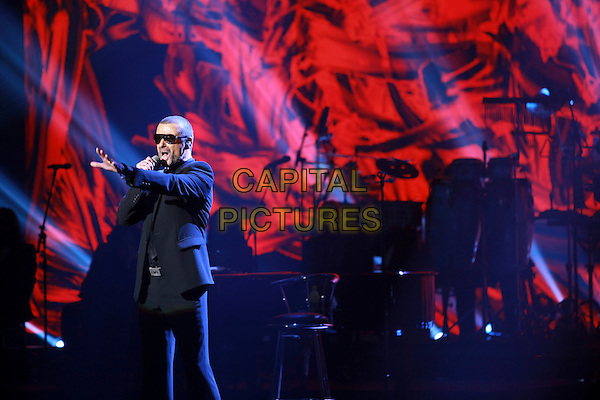 George Michael.premieres his European Orchestral Tour 'Symphonica' at the Prague State Opera House, Czech Republic  22nd August 2011..performing concert gig live on stage singing black suit sunglasses half length shades hand arm.*Editorial Use Only*.CAP/PLF.Supplied by Capital Pictures.