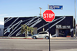 Urban landscape of Los Angeles with gallery building and stop sign.