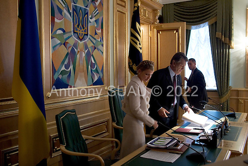 Kiev, Ukraine.August 29, 2005 ..Ukrainian Prime Minister Yulia Temichenko and President Victor Yushchenko greet before a financial budget meeting for the coming year with government officials and economic experts.