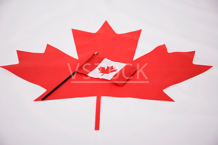 Canadian flag on large maple leaf symbol