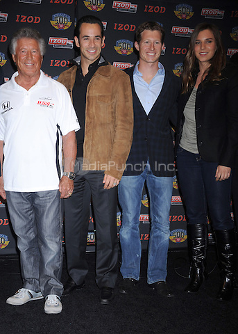 NEW YORK, NY- MARCH 23: Mario Andretti, Helio Castroneves, Ryan Briscoe and Simona de Silvestro at the Izod party to celebrate the 100th Anniversary Indianapolis 500 at Classic Car Club on March 23, 2011 in New York City. © mpi01 / MediaPunch Inc.