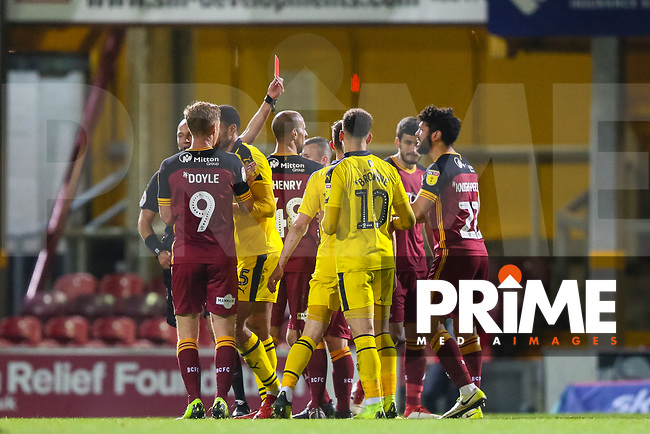 Nathaniel Knight Percival of Bradford City is sent off by referee Darren Drysdale during the Sky Bet League 1 match between Bradford City and Oxford United at the Northern Commercial Stadium, Bradford, England on 24 November 2018. Photo by Thomas Gadd.