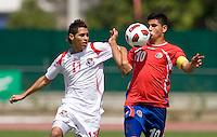 Bryan Santamaria (17) of Panama fights for the ball with Gabriel Leiva (10) of Costa Rica during the quarterfinals of the CONCACAF Men's Under 17 Championship at Catherine Hall Stadium in Montego Bay, Jamaica. Panama defeated Costa Rica, 1-0.