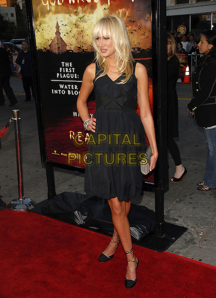 "KIMBERLEY STEWART .The Warner Brothers' Pictures L.A. Premiere of ""The Reaping"" held at The Mann Village Theatre in Westwood, California, USA..March 29th, 2007.full length black dress hand on hip Kimberly lace up strappy shoes silver clutch purse .CAP/DVS.©Debbie VanStory/Capital Pictures"