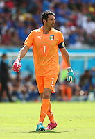 Italy goalkeeper Gianluigi Buffon wears odd coloured Puma goalkeeping gloves and boots