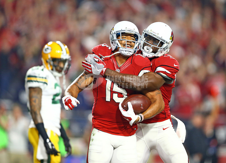 Jan 16, 2016; Glendale, AZ, USA; Arizona Cardinals wide receiver Michael Floyd (left) celebrates a touchdown catch with Jaron Brown against the Green Bay Packers during an NFC Divisional round playoff game at University of Phoenix Stadium. Mandatory Credit: Mark J. Rebilas-USA TODAY Sports