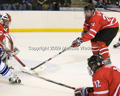 Michael Zador (Canada - 30), Calvin de Haan (Canada - 24) - Finland defeated Canada 5-4 (so) in the 2009 World Under 18 Championship bronze medal game at the Urban Plains Center in Fargo, North Dakota, on Sunday, April 19, 2009.