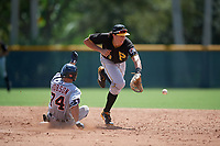 Pittsburgh Pirates shortstop Cole Tucker (3) tries to field a ball as Jacob Robson (74) slides into second base during a Florida Instructional League game against the Detroit Tigers on October 2, 2018 at the Pirate City in Bradenton, Florida.  (Mike Janes/Four Seam Images)