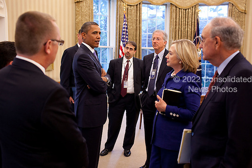 United States President Barack Obama talks with members of his Middle East Policy team, including from right, George Mitchell, special envoy for Middle East Peace; Secretary of State Hillary Rodham Clinton;  Dennis Ross, senior director for the Central Region; and Dan Shapiro, senior director for the Middle East, in the Oval Office, September 1, 2010..Mandatory Credit: Pete Souza - White House via CNP