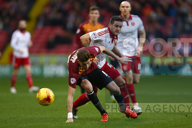 Sheffield United's Billy Sharp battles Reece Burke of Bradford - Sheffield United vs Bradford City - Skybet League One - Bramall Lane - Sheffield - 28/12/2015 Pic Philip Oldham/SportImage