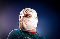 Luis Villa (cq) wears a Lucha Libre mask in support of Mexico during an exhibition soccer game played by Mexico and Colombia at the Cotton Bowl in Dallas, Texas, USA, Wednesday, Sept., 30, 2009. Colombia won the game 2-1, which was played as the second game of a double header after an FC Dallas soccer game in an attempt by Major League Soccer to draw a new crowd of hispanic people to the sport in the US...PHOTOS/ MATT NAGER