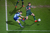 Luke O'Nien of Wycombe Wanderers hits a shot at goal under pressure from Sonny Bradley of Plymouth Argyle during the Sky Bet League 2 match between Wycombe Wanderers and Plymouth Argyle at Adams Park, High Wycombe, England on 14 March 2017. Photo by Andy Rowland / PRiME Media Images.