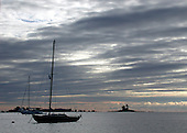 Anchored in Ziegler's cove, Norfolk, CT.  The morning's early light rising with the promise of a good day's sail.