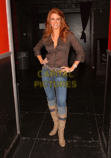 ANGIE EVERHART .At Dave Navarro's Spread Entertainment weekly internet show,episode 3 on Maniatv.com held at The Dragonfly in Hollywood, California, USA..May 31st, 2007.full length brown shirt jeans denim pattern beige boots rolled turned up hands on hips.CAP/DVS.©Debbie VanStory/Capital Pictures