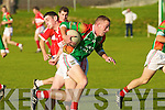 Dingle's Po?l O? Ge?ibheannaigh and St Michaels Foilmore's Sean Fogarty. .