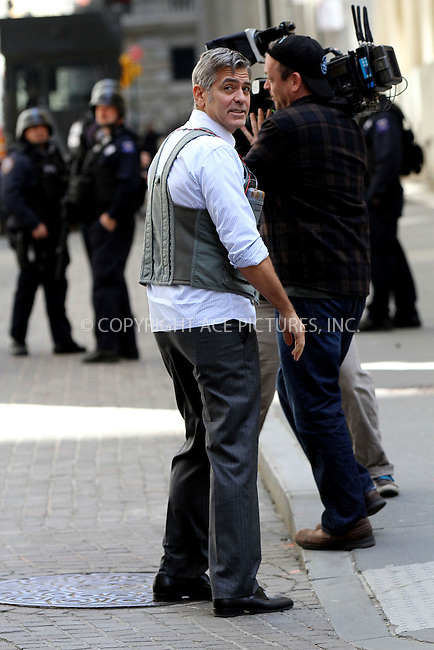 WWW.ACEPIXS.COM<br /> <br /> April 12 2015, New York City<br /> <br /> Actor George Clooney was on the downtown set of the new movie 'Money Monster' on April 12 2015 in New York City<br /> <br /> By Line: Nancy Rivera/ACE Pictures<br /> <br /> <br /> ACE Pictures, Inc.<br /> tel: 646 769 0430<br /> Email: info@acepixs.com<br /> www.acepixs.com