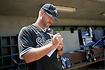 4 JUNE 2016: Greg Brown, Head Coach of Nova Southeastern University fills out the lineup card before their game against Millersville University in the Division II Men's Baseball Championship held at the USA Baseball National Training Complex in Cary, NC.  Nova Southeastern University defeated Millersville University 8-6 to win the national title. Grant Halverson/NCAA Photos